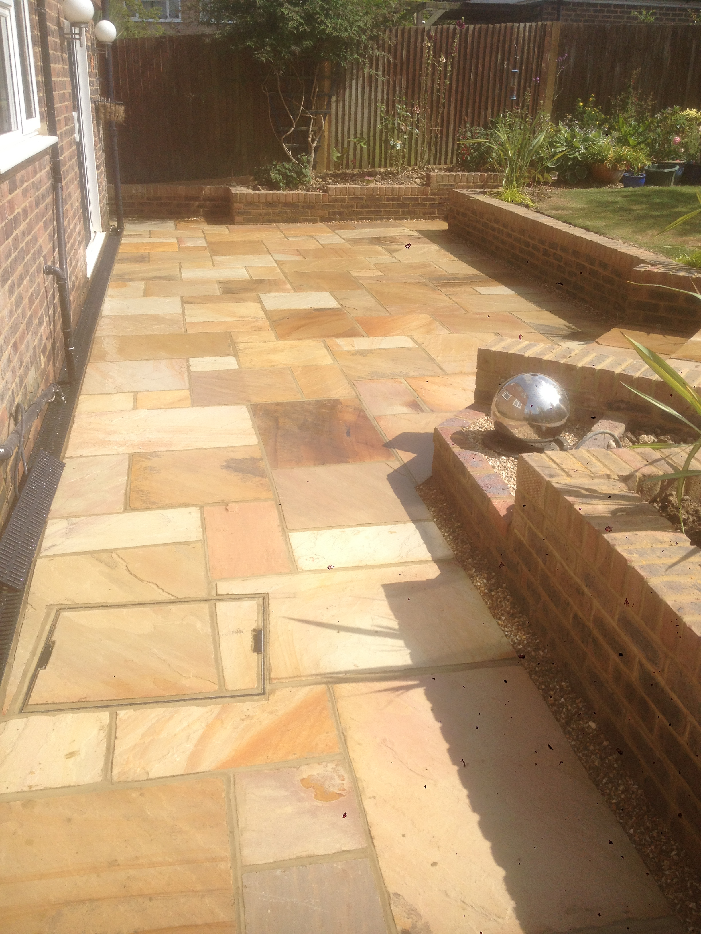 Patio with raised garden in horsham area