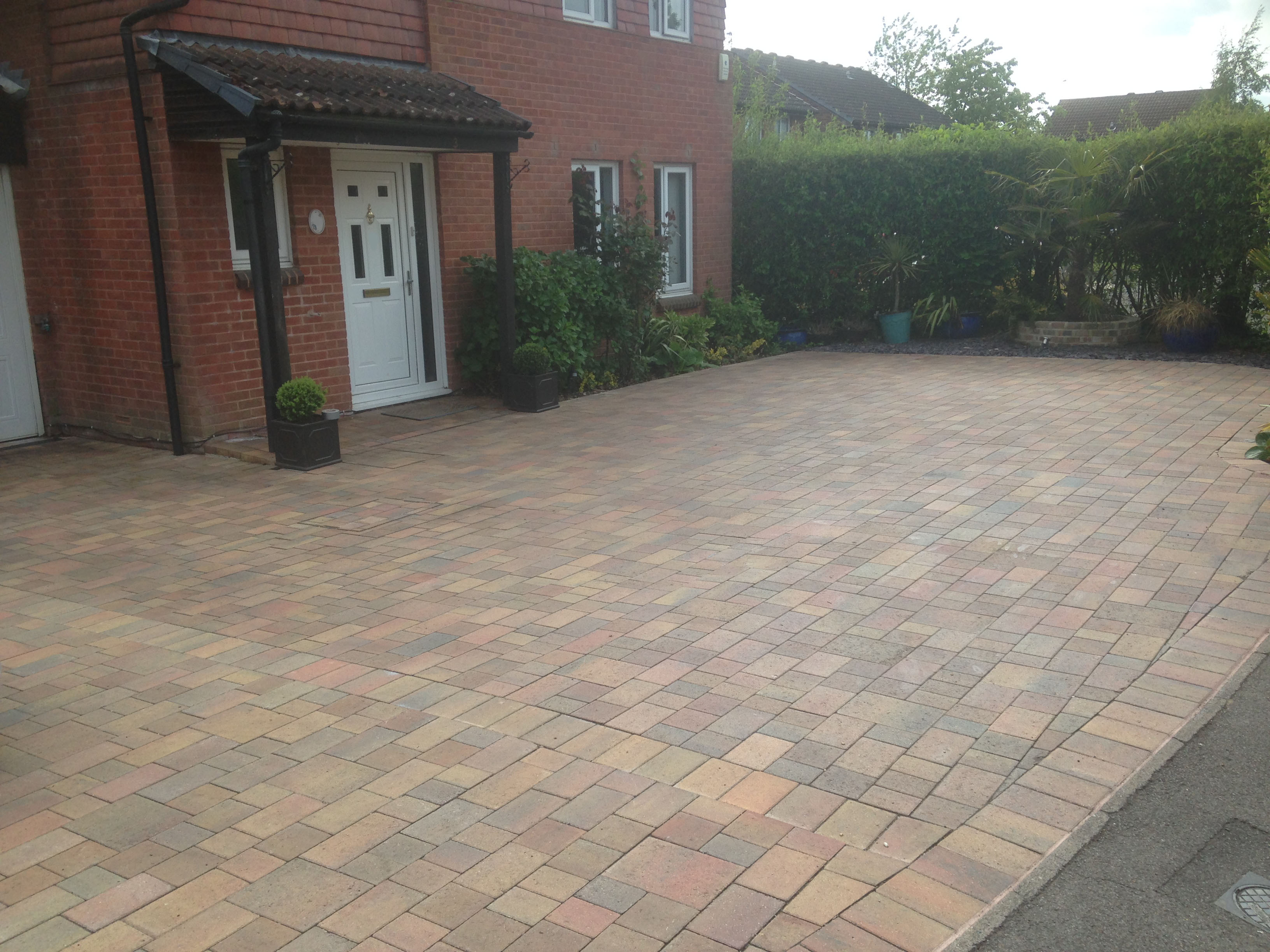 new driveway and slate flower boarders