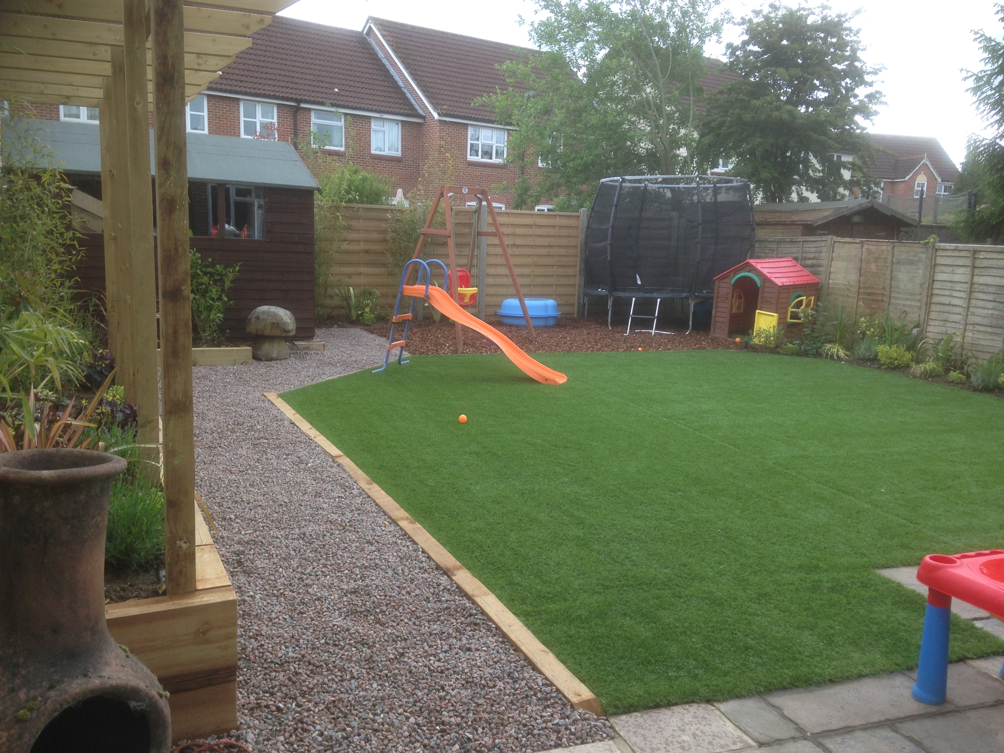 garden with wood bark play area in horsham area
