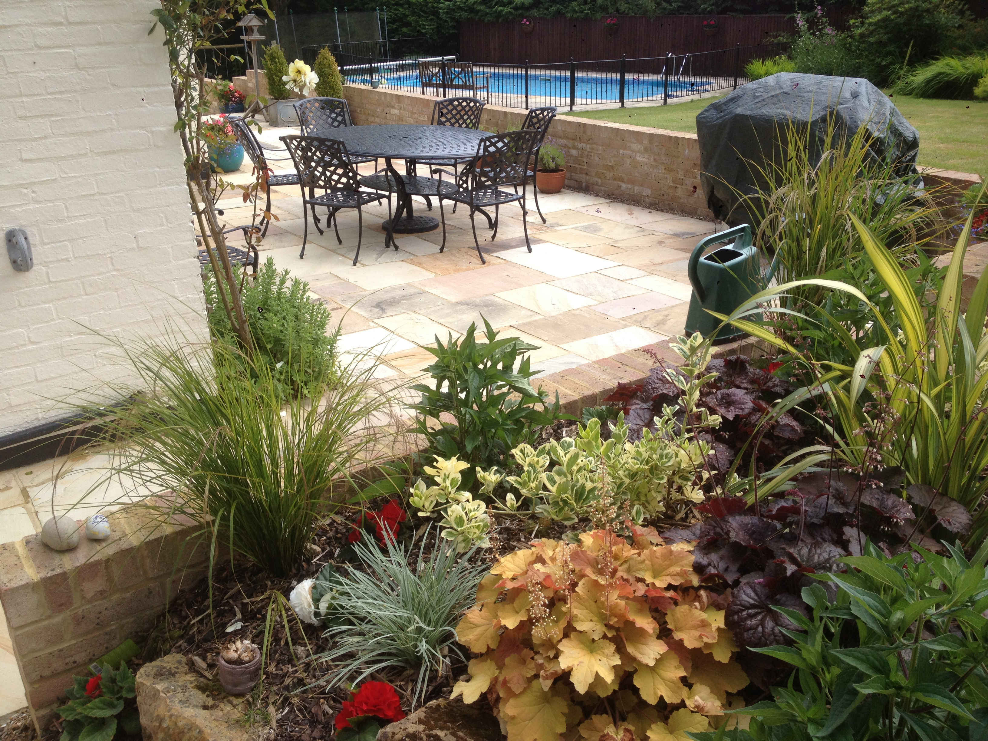 Garden designed in horsham area with pool, patio and new planting