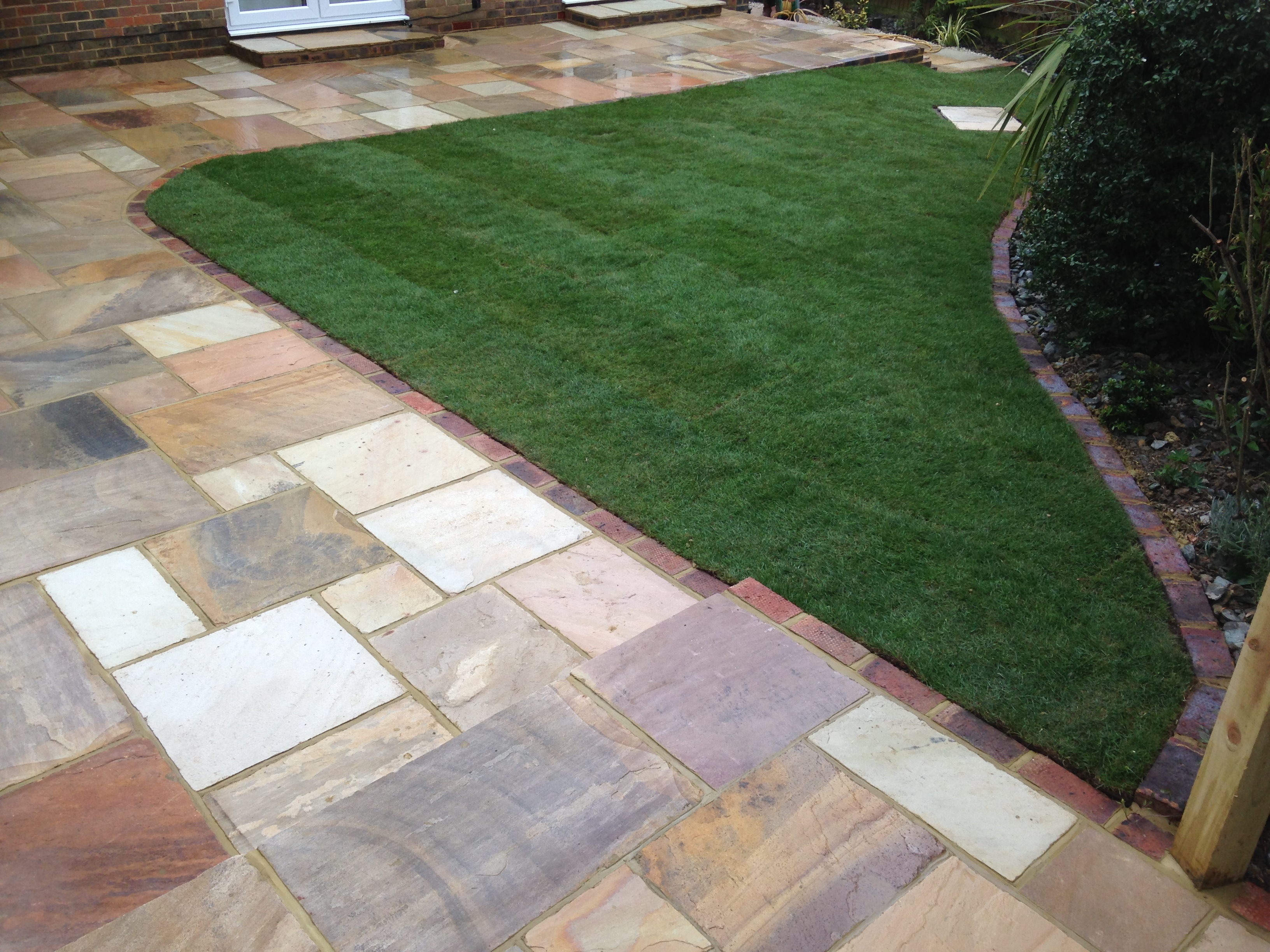 New lawn with brick stone edging