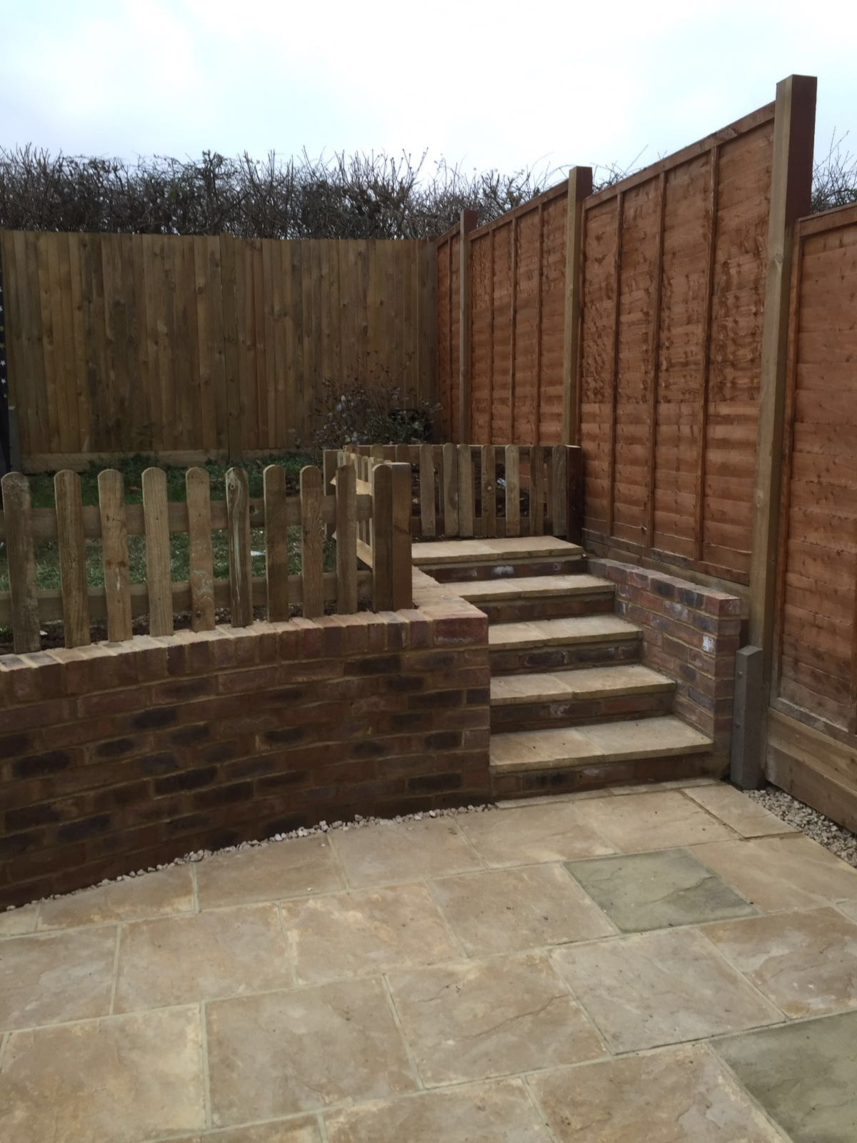 garden landscaped and new patio and walled lawn