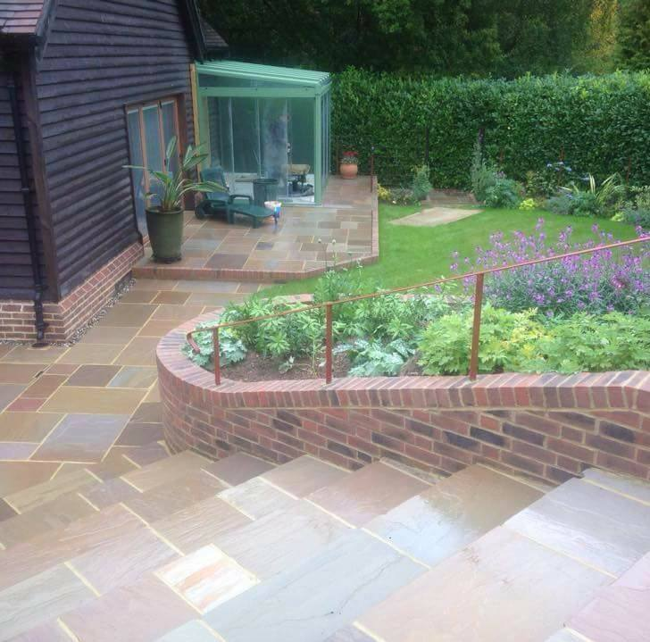 new steps and patio in sloped garden