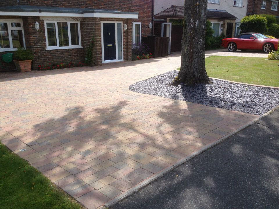 new driveway with slate stone surrounding tree