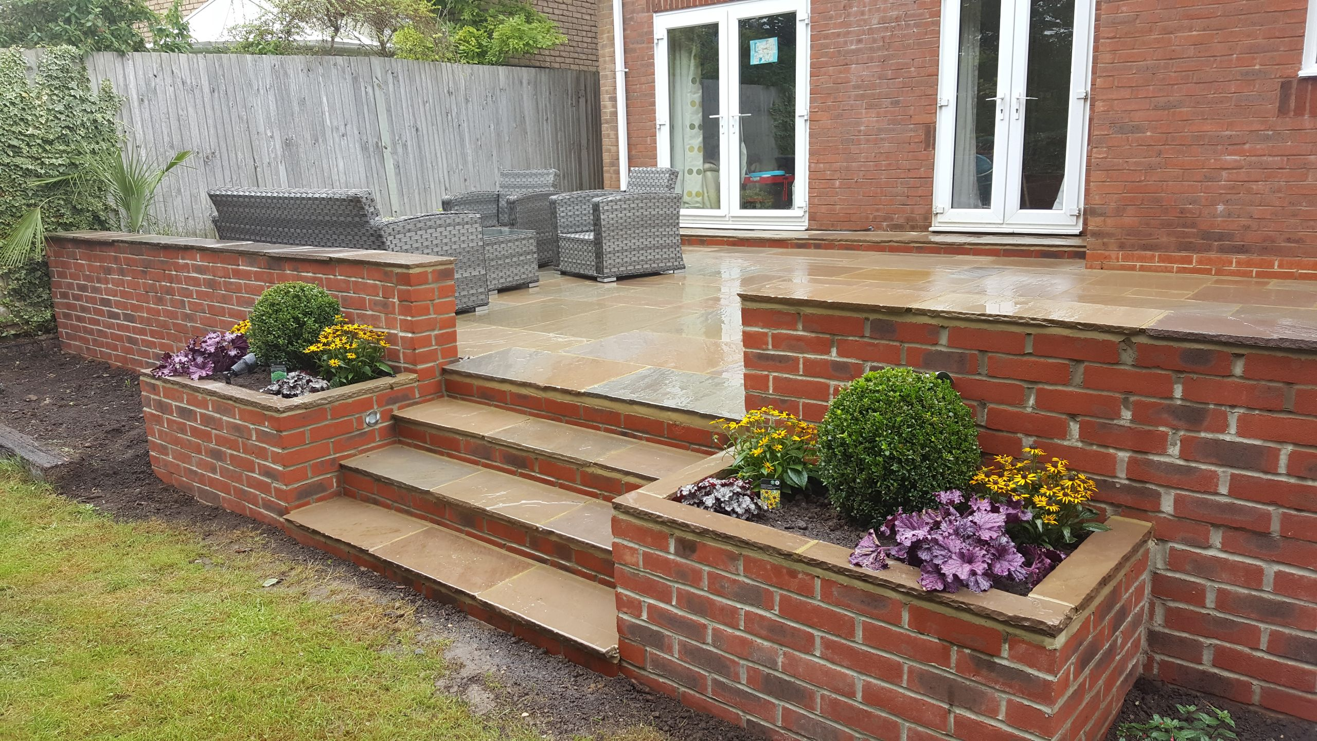 Stepped Pation with retaining wall in Horsham