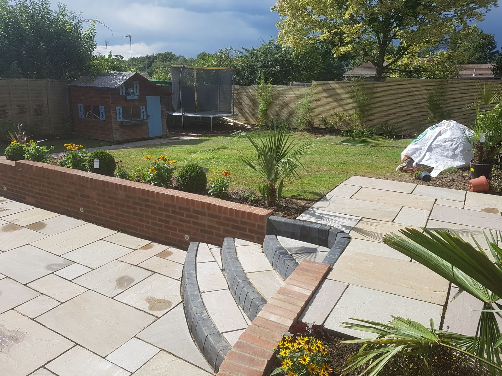 Patio with corner steps garden design in horsham area
