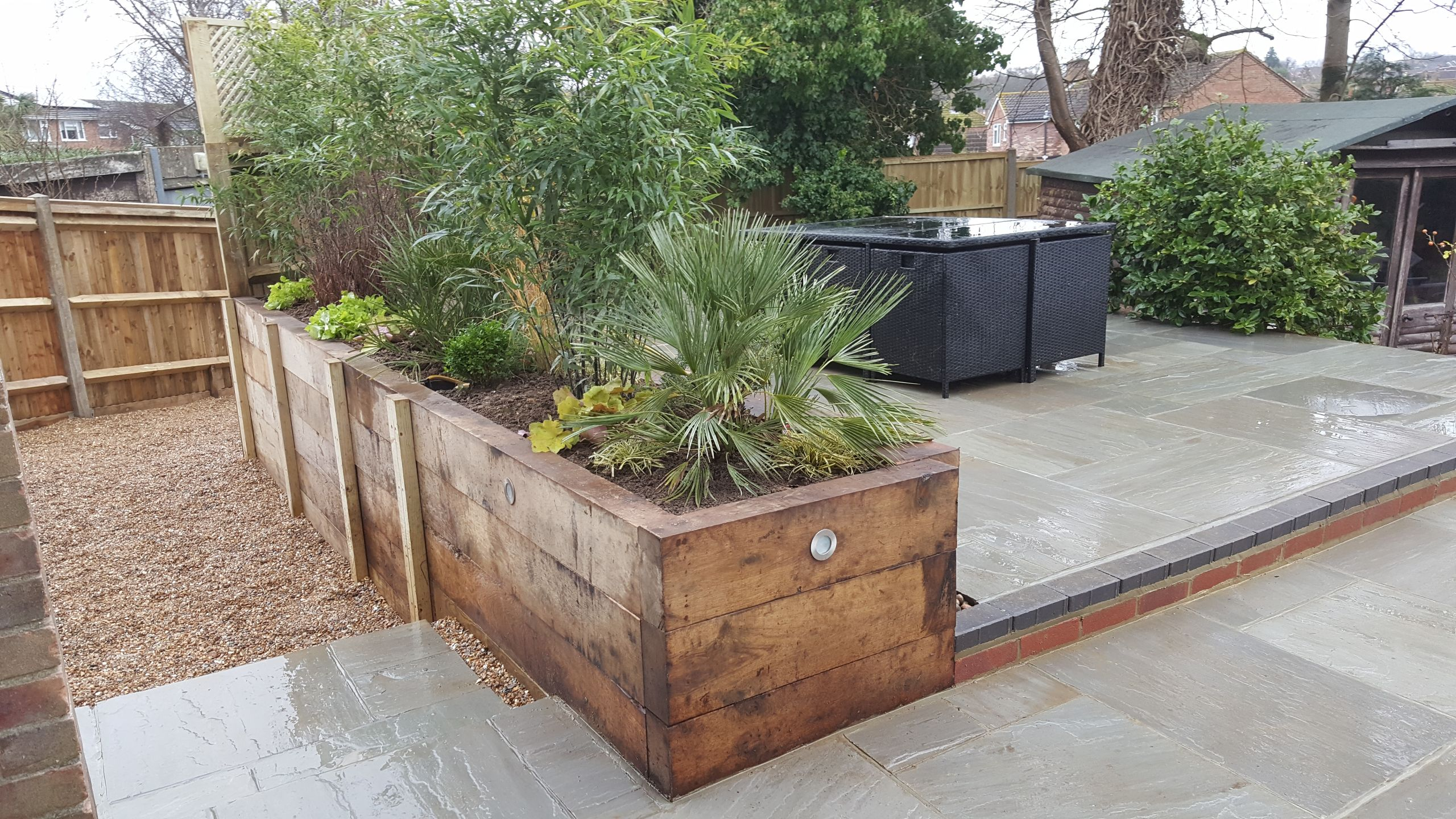 Garden with lighting and raised beds designed in Horsham area