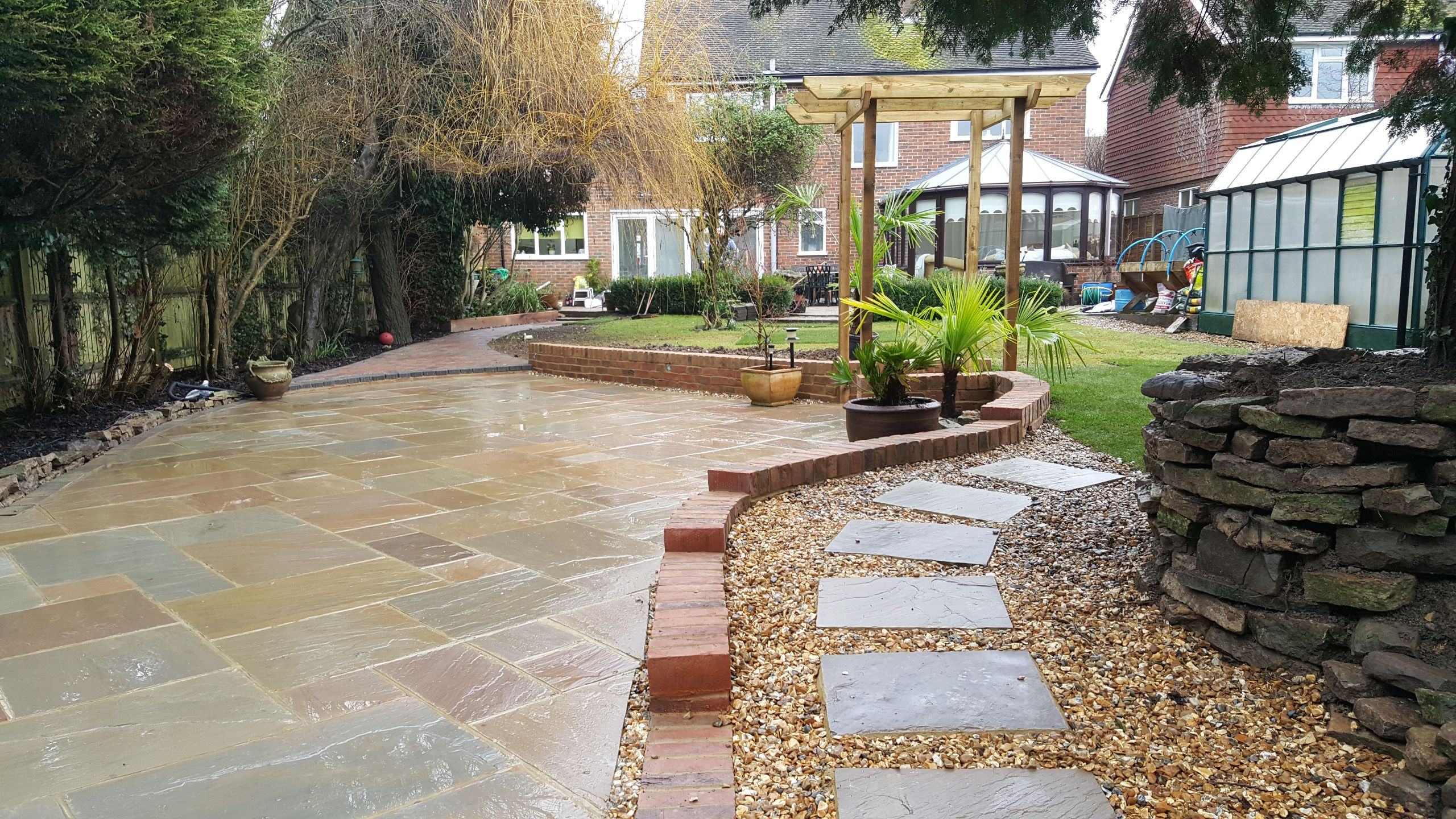 Long garden with curving patio designed in horsham area