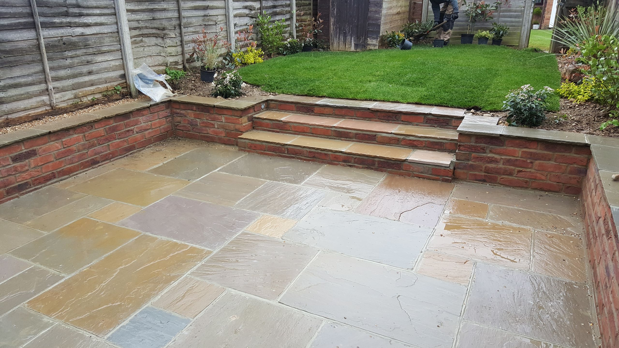 Garden landscaped in Horsham with Patio, steps and turf