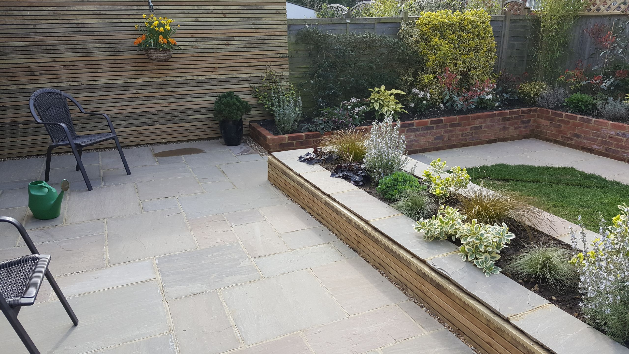 Raised flower beds and patio, Garden Design