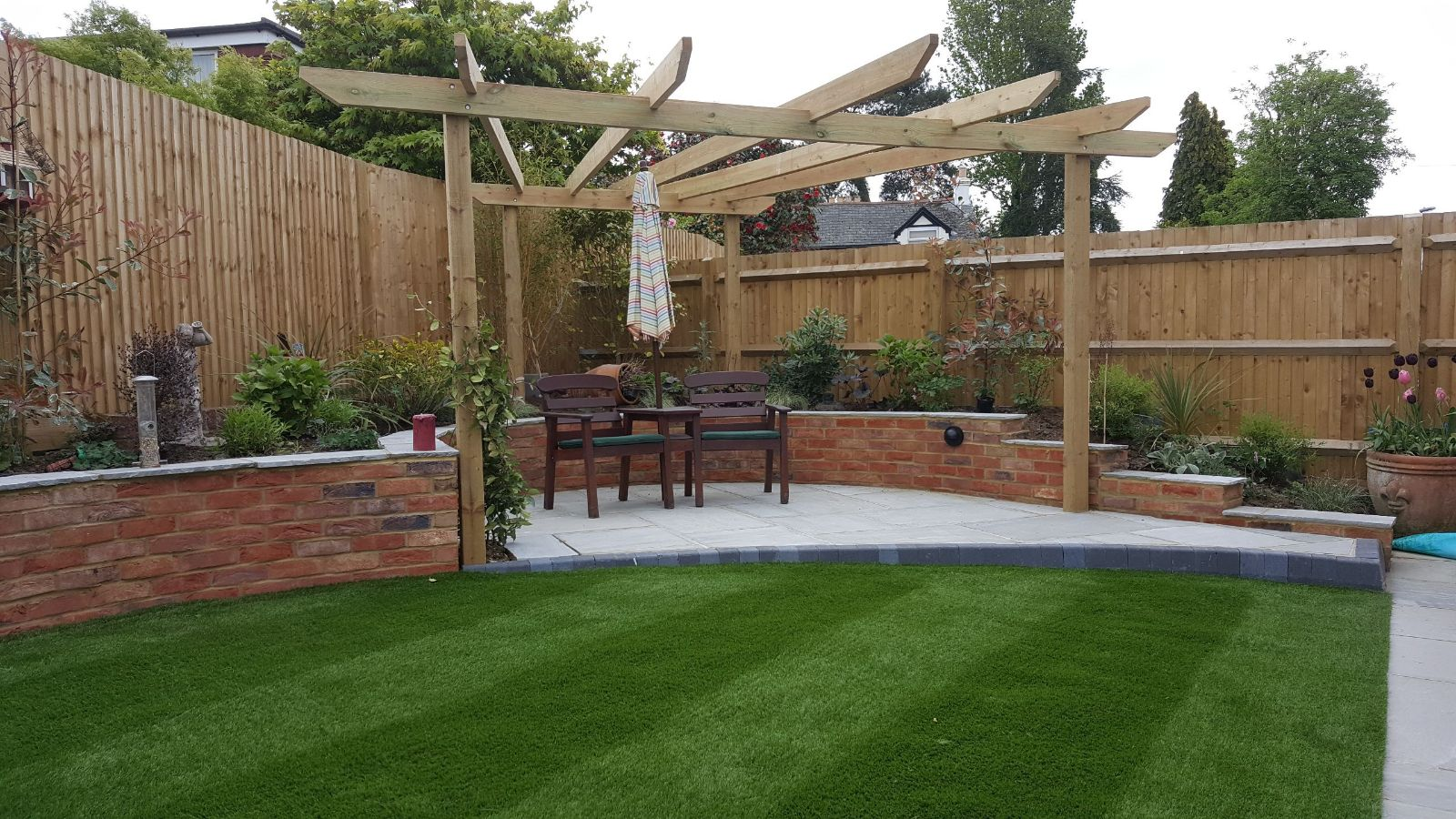 Seating area in new garden with pergola