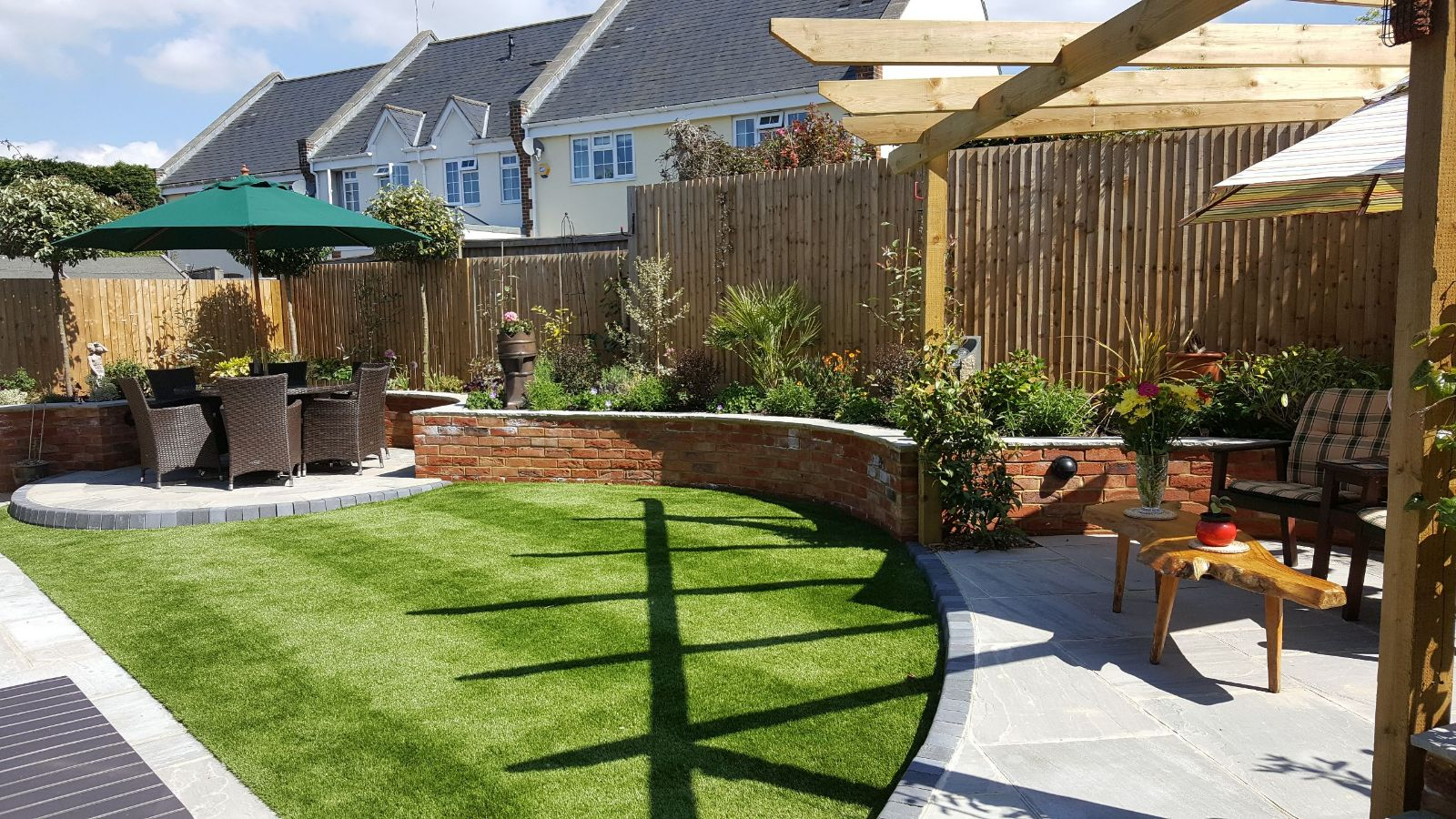 the sun shines down on this well designed garden in Horsham area