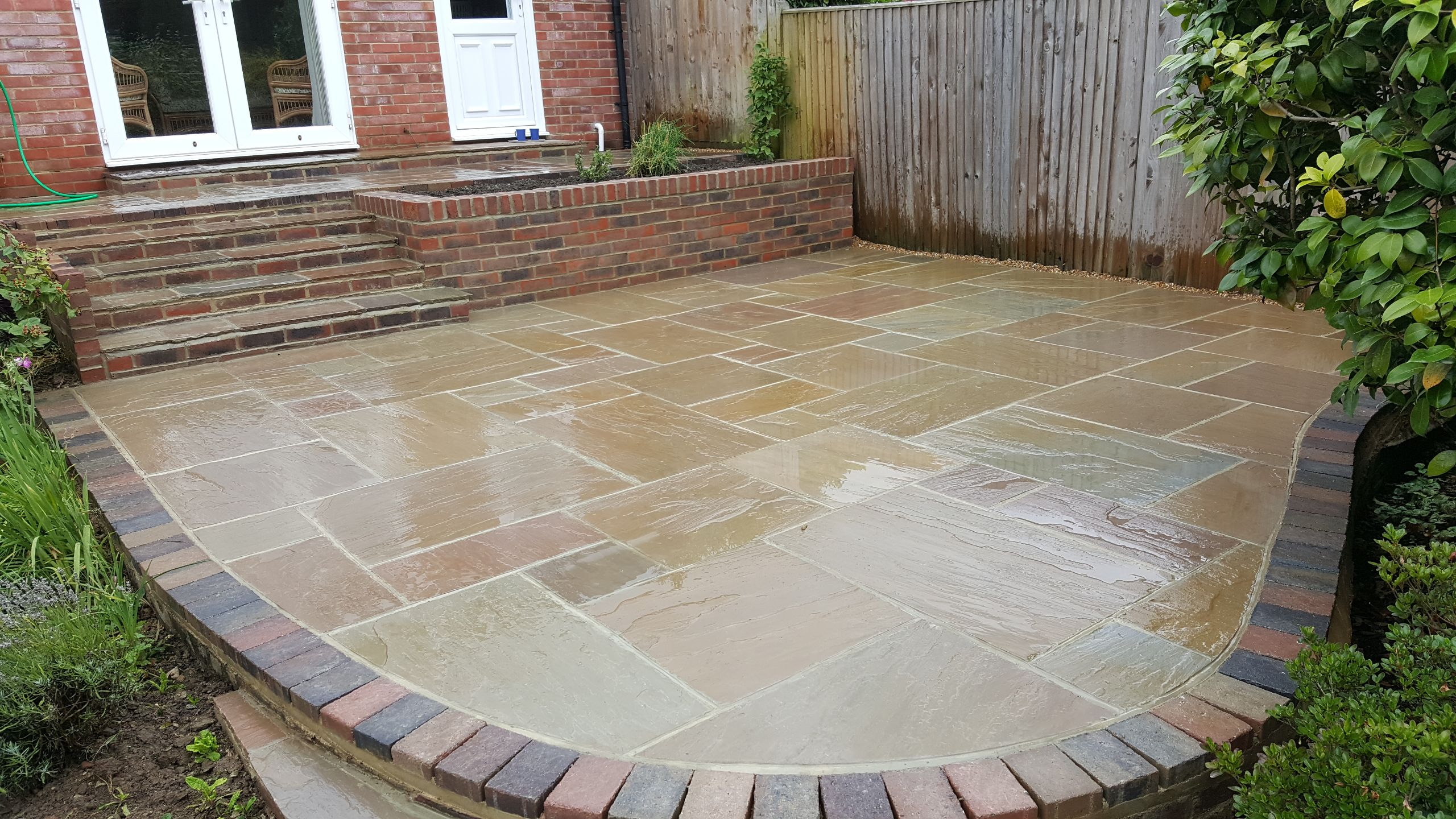 Curved brick edge patio
