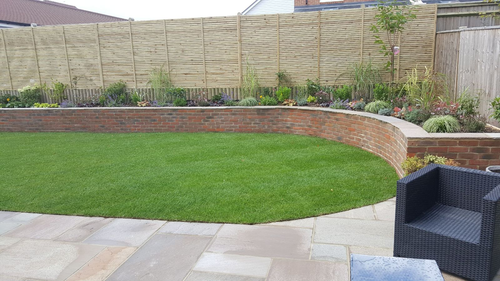 arched wall and new lawn