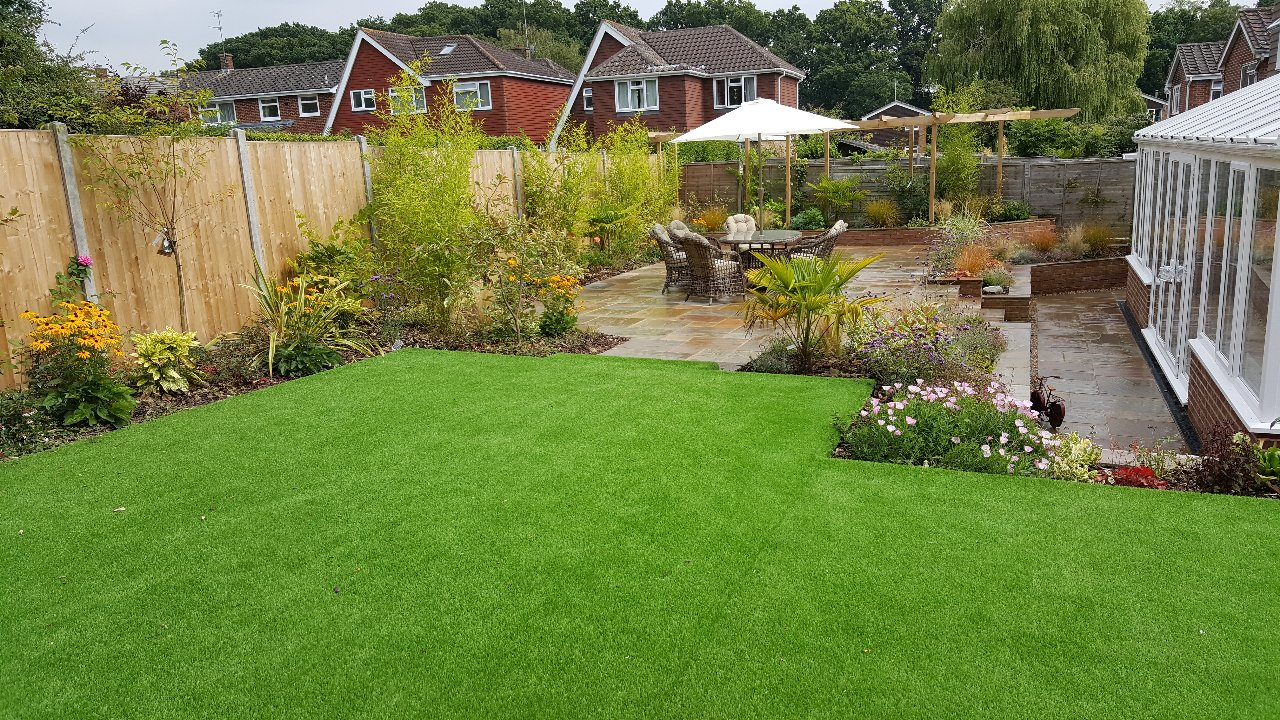 garden design with new planting artificial grass and large patio area