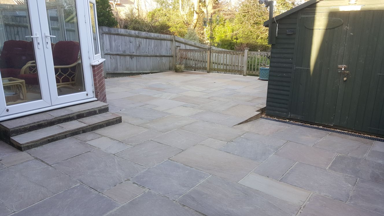 Patio with small ramp to shed and fenced surrounds