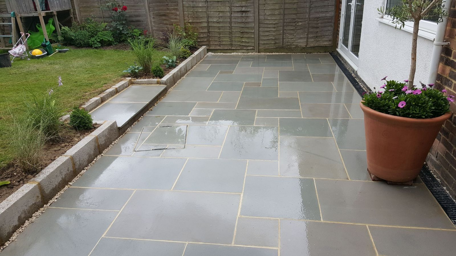 Patio with potted tress designed in horsham